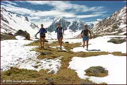 Runners in the Jampamayo Valley on the high circuit around Mount Ausangate