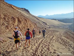 Runners descending to the Valley of Death - Atacama Marathon